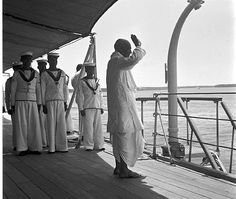 Standing on the INS Delhi, Sardar Vallabhbhai Patel bids farewell to the receding shores of Cochin after concluding his visit to the United State of Travancore-Cochin in May 1950.