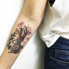 Floral stag piece on forearm by Faith Odabas
