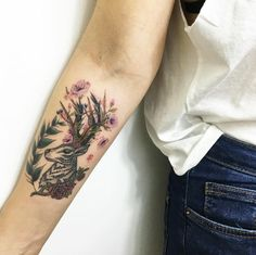 Floral stag piece on forearm by Faith Odabas