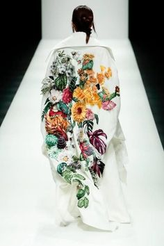 Nguyen Cong Tri - A 3-D Botanical Beauty! We love this creative and bold art piece on a stark white backdrop. Spring is in bloom!