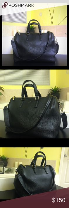 Auxiliary leather satcheL Auxiliary genuine leather satchel. Boston style bag with removable strap with silver stamp and hardware. Bought from Aritzia store. Great bag and very classy and trendy. In great condition. Aritzia Bags Satchels