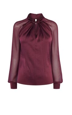 Dark red blouse with contrast sheer, long sleeves with wide cuffs. It features cut out and neck tie detail.