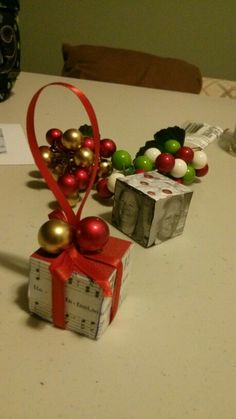 My Christmas tree decoration :wood block, music sheets, ribbon, balls or bells
