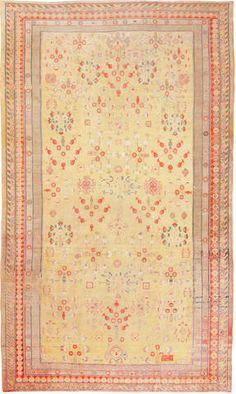 A Khotan carpet  Turkestan size approximately 11ft. 3in. x 19ft. 6in.