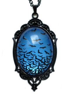 This gorgeous flying bats necklace is made from a glass cabochon and teal metallic paint. It measures and sits in a black enameled frame. Comes with black chain. Goth Jewelry, Fantasy Jewelry, Jewelry Sets, Gemstone Jewelry, Silver Jewelry, Unique Jewelry, Jewelry Watches, Jewelry Necklaces, Jewellery Box