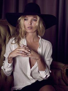 white blouse, black wide rim hat - classic.