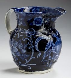 """Northeast Auctions 8/20/16 Lot: 1.  Estimate: $1,000 - 1,500. Realized: $780 (650).   Description: 'EAGLE, SCROLL IN BEAK,' RARE DARK BLUE HISTORICAL STAFFORDSHIRE JUG OF MELON FORM, WILLIAM ADAMS IV & SONS, STOKE, 1829-35, with a displayed eagle under the spout bearing a shield on its breast and clutching a laurel branch and brace of arrows, the banner in its beak inscribed """"E. PLURIBUS UNUM"""". 6 1/2"""" h."""