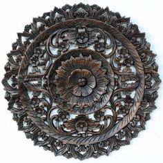 @Overstock.com.com - Round Black Stain/Dark-wax Finish Carved Lotus Recycled Teak Panel - A detailed carving of the Lotus theme in a smaller round size. Several recycled rough-hewn teak planks from old dwellings and community buildings are joined together and then carved as a single unit.  http://www.overstock.com/Worldstock-Fair-Trade/Round-Black-Stain-Dark-wax-Finish-Carved-Lotus-Recycled-Teak-Panel/6817615/product.html?CID=214117 $119.99