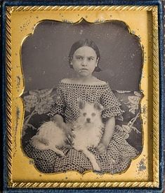 Antique photo of a girl with scruffy terrier on her lap. circa 1860.