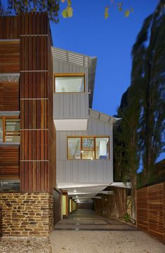 Gorgeous mdoern trend in Australia - wood creates a dramatic and organic look on these buildings.