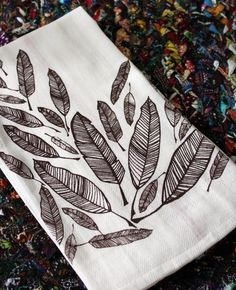 Feather Screen-Printed Dishtowels-set of 2. $12.00, via Etsy.