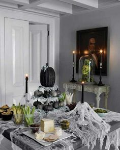 Gauzy spider webs add ghoulish whimsy to an otherwise basic table