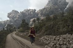Folklore of an Angry Mountain. In local Indonesian folklore, Sinabung volcano is guarded by the spirit of a woman of uncommon purity. Years ago, one tale goes, a young woman of good heart, who lived in the Karo region around the volcano, grew frustrated with her family and ran away to the mountain. There she changed into a spirit that now guards Sinabung, bringing the wind and rain and clouds whenever someone offends her.