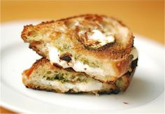 The Mozzarella Pesto Panini -- Made this yesterday and today.  Bought a loaf of italian bread from the bakery at Price Chopper, used pesto from a jar and sliced up some fresh mozzarella I got at Costco.  I sprayed the bread with cooking spray instead of butter and cooked three minutes on each side.  I used my dutch oven on top on the cooking sandwiches as a panini press.  Quick, easy, and yummy.  I even wrapped one up and brought to work then reheated in the microwave for a minute.