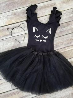 STOP it right MEOW. You have got to be kitten me. Did we seriously just create the cutest Cat Halloween Costume? I think so! Perfect for all our feline loving friends.  Not into all those trendy Halloween costumes but still want your little babe to look adorable? This tradition Cat Tutu Costume with a trendy twist was made with you in mind. Add a little kitten nose and whisker face paint and you'll have everyone stopping to admire!  Our full Cat Costume comes with black leotard matching…