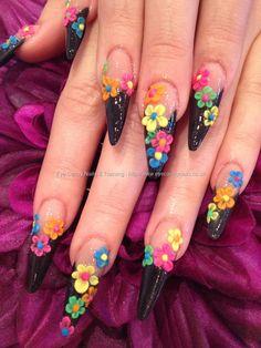 Nail Technician:Elaine Moore  Description: Sculptured black stiletto tips with multicoloured neon 3D acrylic nail art