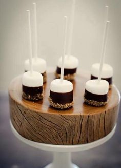 Pretty Little Things- marshmallow dipped in choc and nuts. could do sprinkles for kids at a wedding or nuts for DIY wedding dessert