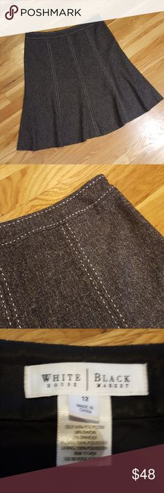 White House Black Market Black Tweed Skirt White House Black Market. Black Tweed Skirt with white stitching. Beautiful A-line design. Lined. Excellent condition. Size 12. White House Black Market Skirts A-Line or Full