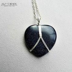 Gorgeous silver flecked blue sandstone heart, wire wrapped on non tarnish wire with your choice high