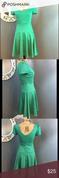 NWOT  Green dress from Mod Cloth Yellow ⭐️ Very flattering fit, flared skirt. The pieced part around the middle is a great figure accent. It has a back zip, v neckline front and back. Never worn, it ended up being a bit shorter than I like to wear for my age. Super cute dress. New without tags. yellow Star Dresses