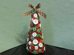 A Christmas Tree made out of a rolled up paper plate and buttons!