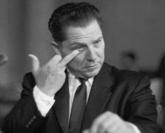 1957, Jimmy Hoffa gives RFK the middle finger at a Senate Hearing.