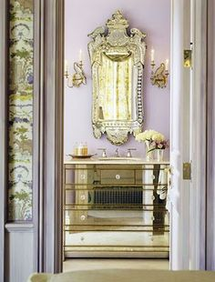 Love the idea of a vintage or an unusual mirror in the bathroom...