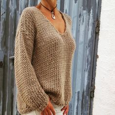 Chunky v neck sweater. Love the color!!