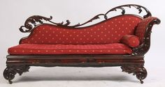 """Nineteenth century mahogany Empire recamier with open scroll work and loose cushion seat. Ht: 38"""" Width: 70"""" Depth: 24"""""""