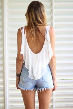 Love the open back shirt and jean shorts.
