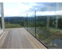 External glass balustrade by iq glass arhitectura for Urban glass fencing