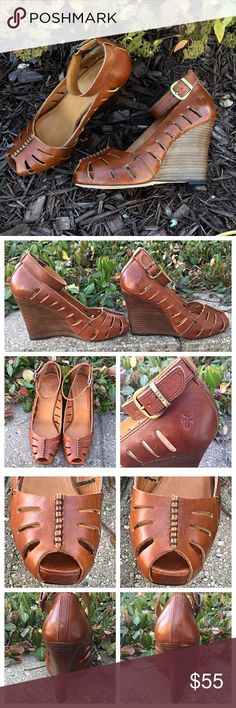 "Frye Gwen Ankle Strap Platform Wedge Trades/Holds Frye Gwen *  Rich cognac leather w/ adj. ankle strap *  Decorative cutouts, peep-toe *  4"" stacked wedge heel, but ¾"" platform makes it feel lower *  Leather lining and sole *  Size 6, about 9.5"" toe-heel inside the shoe, 3"" @widest pt on sole *  Pre-loved, leather soles hardly worn (pic 4), leather is meant to burnish & show marks to be vintage-y, mark on side of right shoe (4), leather has been freshly conditioned  Plz ask ?s esp. about…"