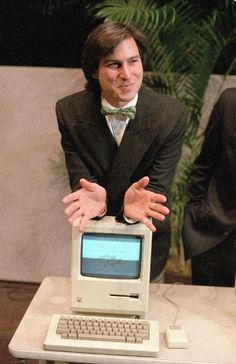 "1984 – Steve Jobs, chairman of the board of Apple Computer, leans on the new ""Macintosh"" personal computer following a shareholder's meeting in Cupertino, Calif. (AP Photo/Paul Sakuma, File)"