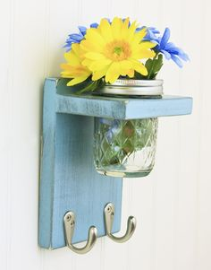 I really need a key holder! This is the only one i found that i like. I am going to make it. I also love the idea of having bright flowers by the door.