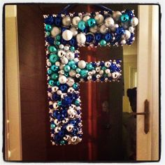 """Festive holiday """"F"""" ornament wreath  Done with poster board, glue gun and ornaments from the 99 cent store!"""