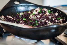 Black rice with prawns, celery and white wine sauce