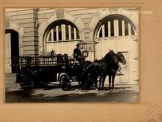 ID#0136 Date: Unknown. This image shows firemen on a horse-drawn fire wagon in front of the old North Main Street. The horses were carefully trained to take their places in front of the wagon as soon as the fire bell rang and their stable doors opened. Participant: Chief Dennis. Additional Sources: Oberlin Heritage Center: City Directories. The Rotary Club of Oberlin, Pictorial Memories of Oberlin, 1976 and 1989.