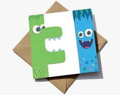 3rd birthday card for a boy. Cute monster characters with the number 3 in the negative space.  The cute characters have the appearance of sugar paper giving them a playful quality that children will love.