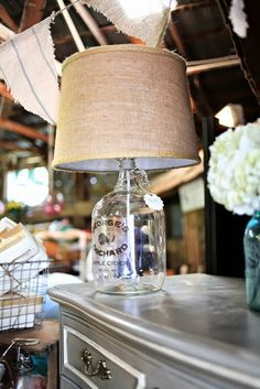 ~ How to Make a Bottle Lamp from a glass jug, including how to drill a hole in glass.