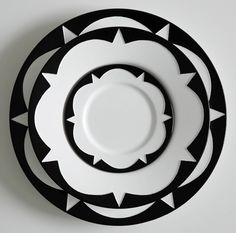 Sound Made Visible Ceramic Tableware: blakebrough + king. The patterns etched onto the plates and bowls are graphic representations of the geometric patterns sound frequencies make on water and salt (cymatics) pinned with Bazaart Ceramic Tableware, Ceramic Pottery, Kitchenware, Black And White Colour, Shades Of Black, Black And White Dishes, Assiette Design, Dining Ware, Dinner Sets
