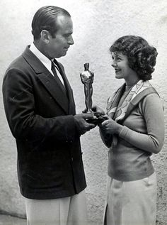 "Douglas Fairbanks presents Janet Gaynor with the first ""Best Actress"" Oscar. Certainly different from the awards today!"