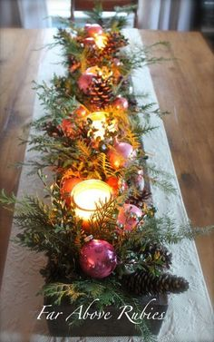 Old box filled with vintage glass ornaments, pine, pine cones, and candles in glass holders makes a festive holiday centerpiece. An outdoor version of this would look great in a window box.