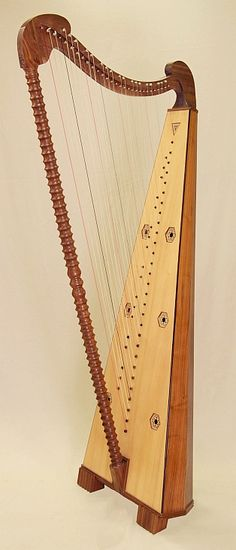 From Thurau Harps: Reconstruction of the chromatic cross-strung double row harp of the spanish harpmaker Ivan de la Tore,   housed in the Cistercian Monastery of St. Ana, Avila-Spain,17th c.