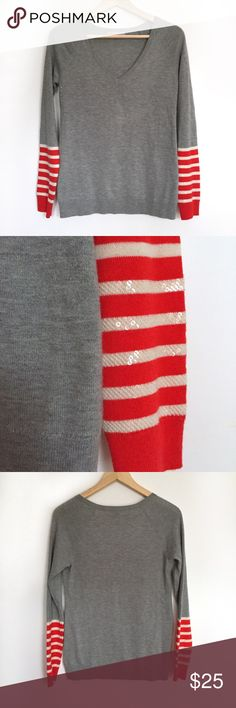 "Gap sequin red white gray striped v-neck sweater Soft, comfy sweater with sequined striped sleeves. Nylon/wool/acrylic. In excellent used condition, no flaws. Size extra small. 17"" armpit to armpit, 25"" shoulder to bottom. GAP Sweaters V-Necks"