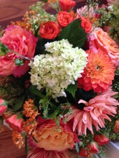 Popping with coral dahlias and Freespirit roses