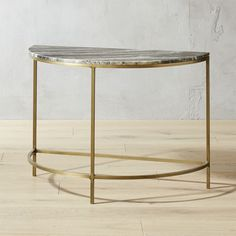 Shop Demi Luna Black Marble Half Moon Side Table.   Honed grey marble in a half moon shape tops a warm, antique bronze-finished base.  Thin and elegant in profile, but sturdy in performance.