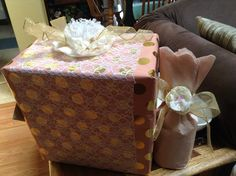 Bridal shower gift wrap with paper, fabric, and lace.