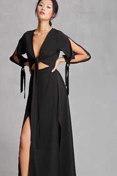 A woven maxi dress by Reverse™ featuring a wrap surplice front with a self-tie, a long maxi skirt with an M-slit, an invisible side zipper, vented long sleeves with self-tie cuffs, and an elasticized back waist.