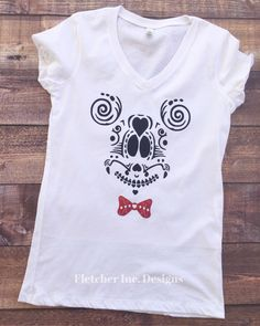A personal favorite from my Etsy shop https://www.etsy.com/listing/476299269/glitter-sugar-skull-mickey-inspired-top
