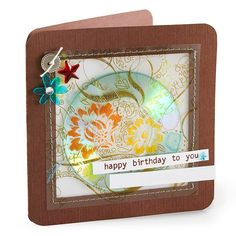 "For a personalized twist on this birthday card, use a computer to record your own rendition of ""Happy Birthday."" Then burn it onto a cute mini CD. Make a pocket card using brown cardstock, patterned vellum, and white paper; tuck the unique gift inside."